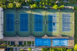 Outdoor and indoor tennis at the Houstonian Club with no resort fee.