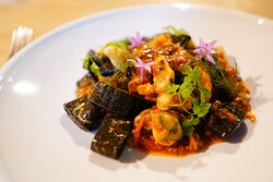 Calamarata . If you are into Squid Ink pasta with Seafood , this will do it for you . Team it with the Chard .