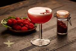 Clover Rose: A floral mix of Mexican Diega Gin with homemade raspberry and pink pepper syrup, lime juice and aquafaba for a smooth texture.