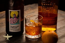 Puertos Old Fashioned: Bulleit Bourbon and Homemade chocolate bitters stirred Puerto Cafes cold brew to give a caffeine fueled kick to this classic speakeasy era cocktail.