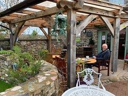 Enlosed patio seating overlooking a pretty garden