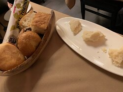 Bread basket and Parmigiano Reggiano to enjoy as you wait for your meal.