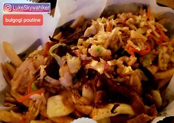 Lots to enjoy but not poutine! no gravy! This is a super fancy loaded fries.