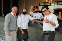 A very happy costumer with Jaime, Arno and Gilberto.