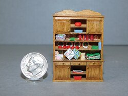 Christmas cabinet by Susan Hoeltge in quarter inch scale