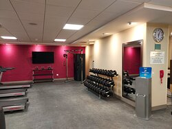 Weights, exercise machine in gym