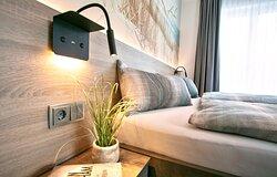 14-tägiger Handtuch- und Bettwäschewechsel sowie Zimmerreinigung im Preis inbegriffen.