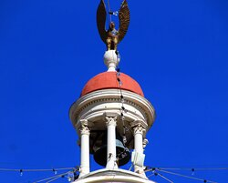 The bell tower is capped with an eagle