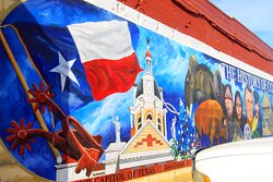 Down a block at main and 9th, across the street from the museum with the largest collection of spurs.  This mural features the Coryell County Courthouse