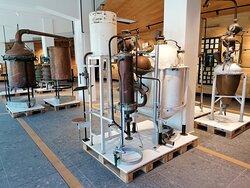 Display of antique distillery equipment.