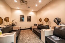 Head steamers in the waiting lounge at Mitchell's Salon & Day Spa