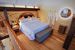 """The Millery's"" cozy mezzanine king bed"