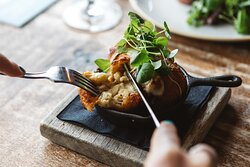 Tuck into hearty dishes, like this deep fried mac 'n' cheese starter