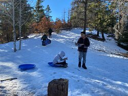 Mountain sledding less than 30 minute drive and many spots to choose from.  Hotel provided loaned sleds. . . . or pick one up from Walmart for less than $10 each.