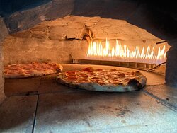 Pizzas artesanales en horno de barro