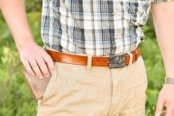 Handmade genuine leather wallet and belt with belt buckle forged by local blacksmith