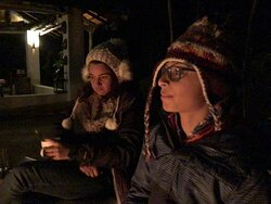 Sitting around bonfire enjoying soup and starters