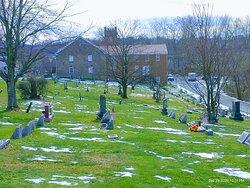 Fells cemetery with United Methodist church