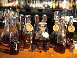 Homemade liqueurs, hedgerow wines and fruit infusions displayed in the Smugglers Bar.