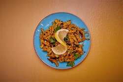 Chicken Sadheko Shredded chicken marinated in sesame oil, spices, onions and chilli.