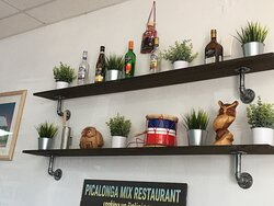 Shelf with bottles and pkants