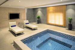 Spa whirlpool and lounge chairs