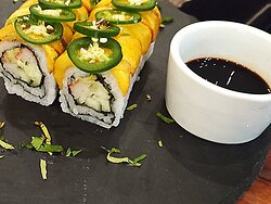Crab, cucumber, cream cheese roll topped with jalapeno and mango.