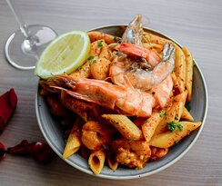 seafood-based pasta dinner option available from the hotels bar & Grill - can be enjoyed from the sundeck, grill, or from the luxury of suite balconies.