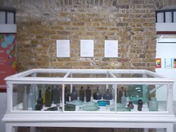 The collection of some medicinal bottles or such on display (on the 1st level)