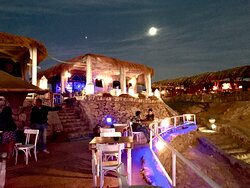 Nausicaa, seen at night from the outdoor (uncovered -- see the stars) dining area. Full moon.