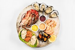 Seafood Platter 4 Oysters, Half Lobster, 4 Langoustine, Dressed Crab, 6 Mussels, 4 Prawns, Potted Shrimp, Mignonette, Curry Mayo, Marie Rose Sauce and Guinness Bread