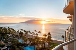Catch a Hawaiian sunset on the balcony of your Ocean View Guest Room.
