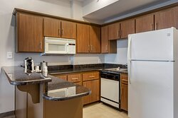 Kitchenette with fridge, microwave, and kitchen sink