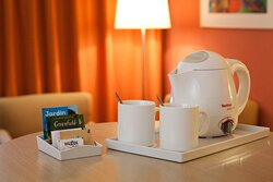 Relax in privacy of your guest room featur?ng coffee and tea set