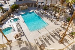 Swimming area provides an oasis with pool, hot tubs, and cabanas.