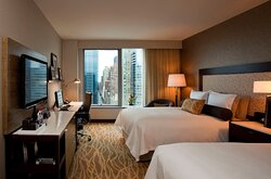 Sky view guest room with two double beds and uptown views.