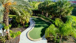 Putting green located behind pool. Clubs and balls available.