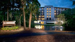 Hotel across the lagoon at night