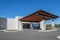 Vast Hotel Entrance offers covered unloading space.