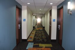 These hallways lead to well-appointed guest rooms and suites.