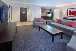 Upscale King Suite Separate Living Room with Wet Bar