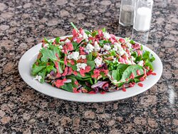 Spring Salad Field greens, candied pecans, gorgonzola, red onions, dried cranberries, and raspberry vinaigrette.