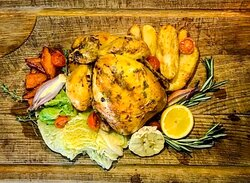 Roast chicken,roast potatoes, sautée cabbage, infused carrots, honey parsnip yorkshire pud  & gravy