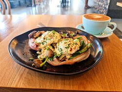 Our Eggs Benedict on an English Muffin, with mushroom, bacon, and hollandaise sauce. Available for only $18!