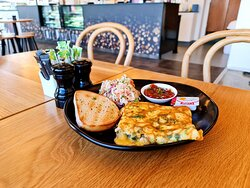The Three-Egg Cheesy  Omelette from our breakfast selection, available for only $14 (or $16 if you'd like the bacon option!)