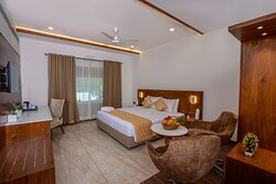 Classic Room       Spacious room, Air conditioning, Bath tub, Separate seating & dining area, LCD TV, extra large spring mattress, Mineral water, Daily news paper, Study table, Fully loaded bathroom toiletries