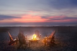 Take a seat by a warming fire pit as the sun goes down
