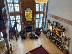 Beautiful front room with pool table to use and pretty sitting area by the fire.