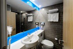 A modern stylish  guest bathroom with shower