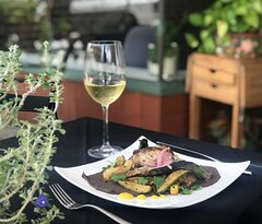 Diners enjoying one of our weekly specials on our patio